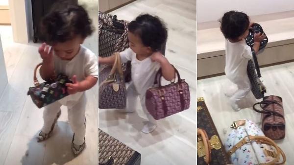 4a1848c15 Filha de Kim Kardashian brinca com bolsas de luxo e exibe look de R ...