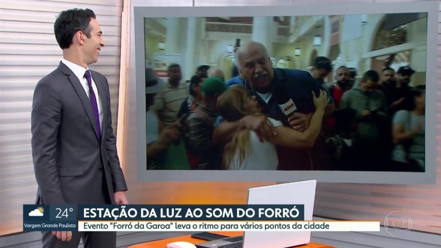 """Márcio Canuto é agarrado por fã durante o """"SP1"""", telejornal local da Globo - Reprodução/TV Globo"""