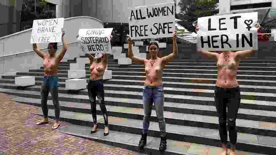 Mulheres de topless se manifestam na Austrália em apoio à jovem saudita - AFP