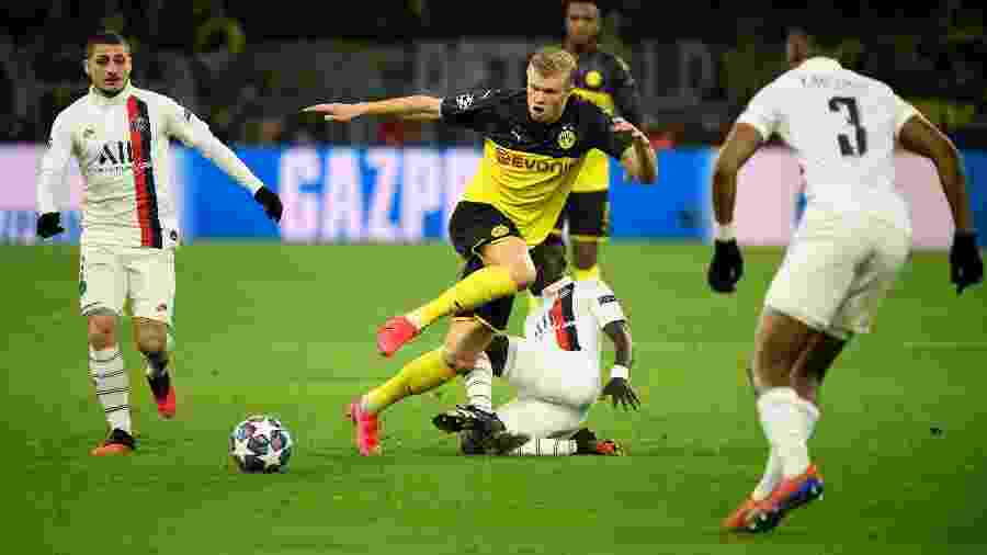 O atacante Erling Braut Haaland, que brilhou pelo Borussia Dortmund diante do PSG, na noite de terça-feira, pelas oitavas de final da Liga dos Campeões - Ina Fassbender / AFP