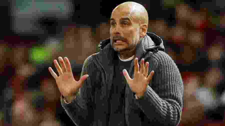 Pep Guardiola acompanha jogo do City - Phil Noble/Reuters