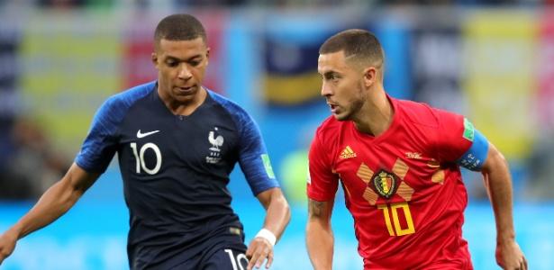 Kylian Mbappé, da França, e Hazard, da Bélgica, disputam bola durante a Copa do Mundo - Alexander Hassenstein/Getty Images
