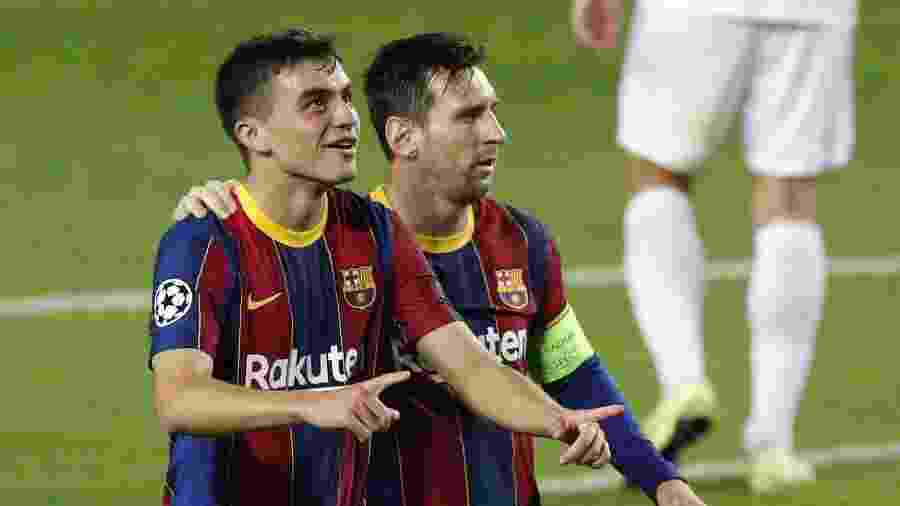 Pedri, ao lado de Messi, comemora seu 1º gol na Champions - Albert Gea/Reuters