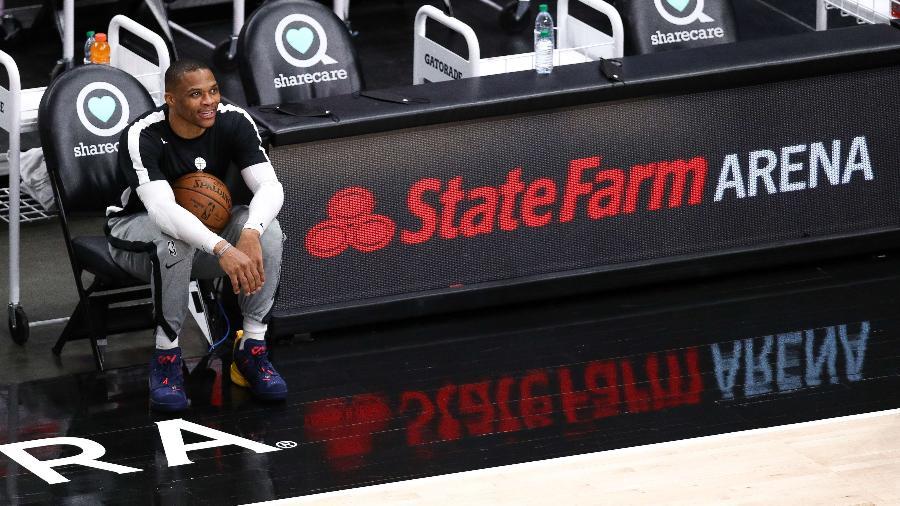 Russell Westbrook sorri antes de jogo do Washington Wizards contra o Atlanta Hawks pela NBA - Casey Sykes/Getty Images/AFP