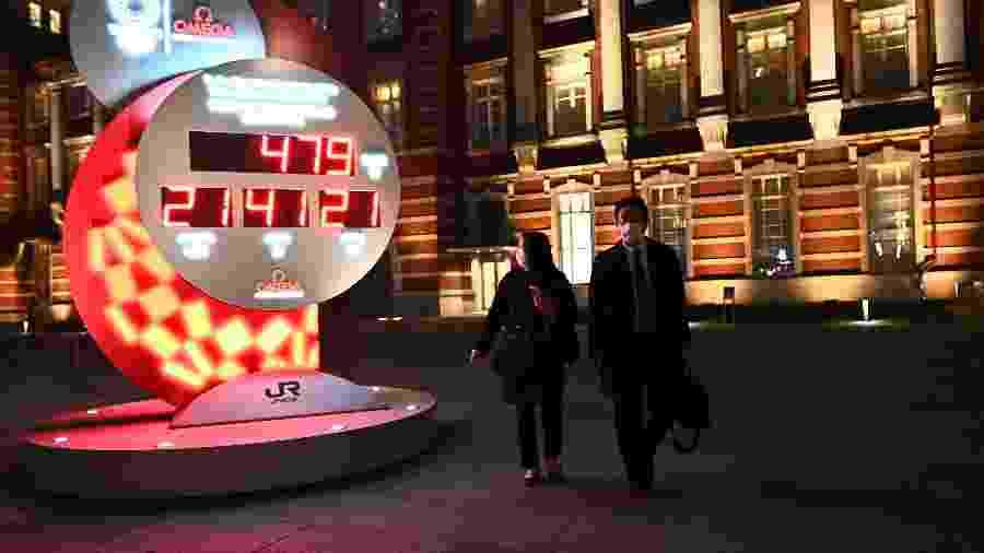 Agora, relógio no lado de fora da Estação de Tóquio marca 479 dias para o início dos Jogos - Philip Fong/AFP