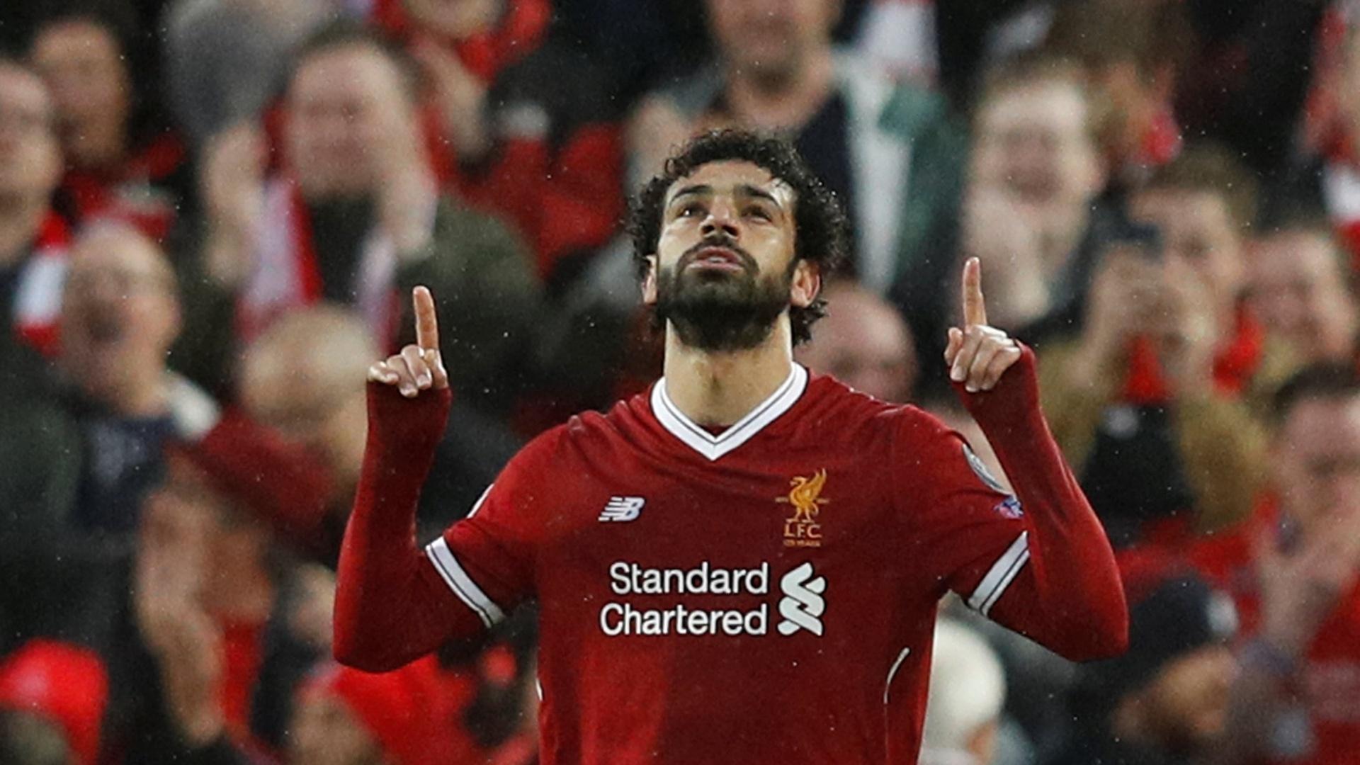 Mohamed Salah celebra seu gol pelo Liverpool contra a Roma