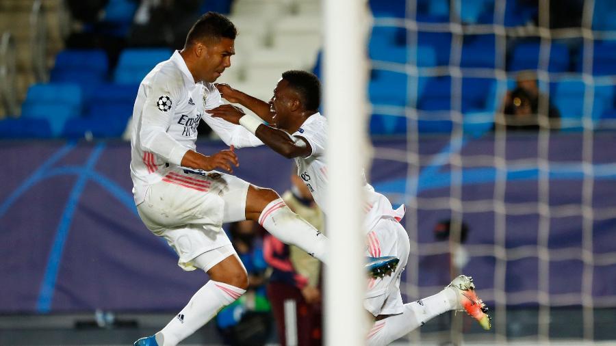 Casemiro e Vinicius Jr em ação pelo Real Madrid na Liga dos Campeões - SUSANA VERA/REUTERS