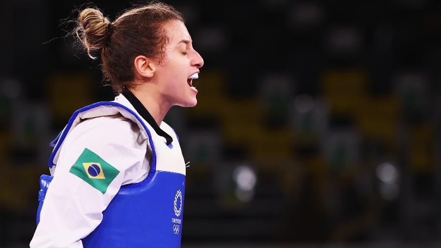 Brasileira Milena Titoneli reage durante luta nas Olimpíadas de Tóquio - Murad Sezer/Reuters