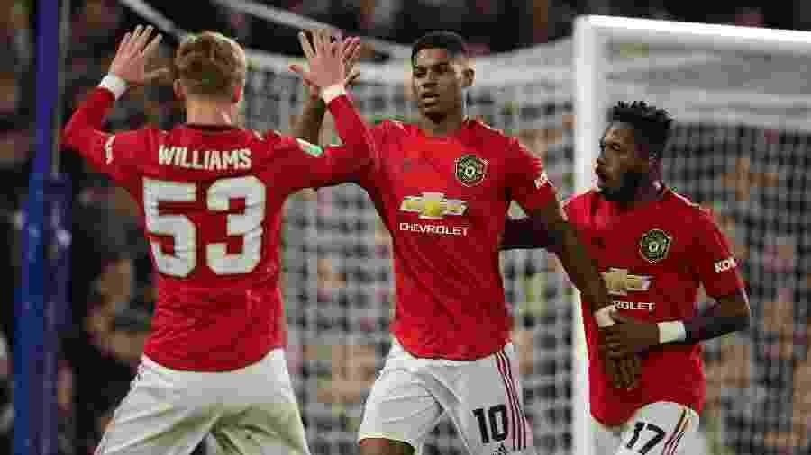Marcus Rashford comemora após marcar pelo Manchester United sobre o Chelsea - Matthew Ashton - AMA/Getty Images