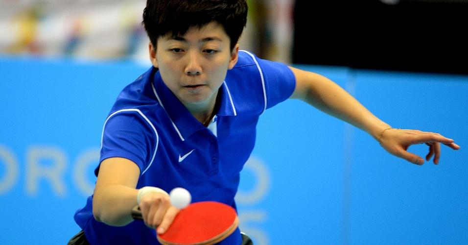 Lin Gui durante partida do tênis de mesa feminino