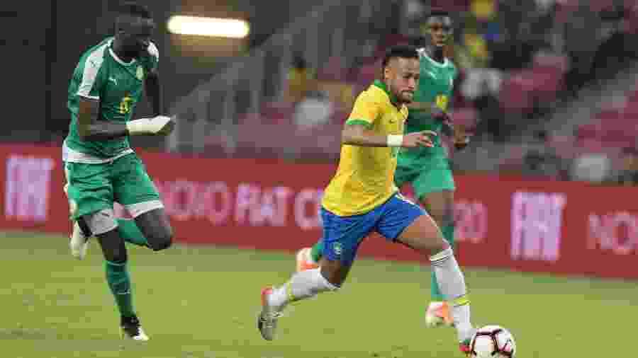 Neymar durante jogo entre a seleção brasileira contra Senegal  - Roslan RAHMAN / AFP