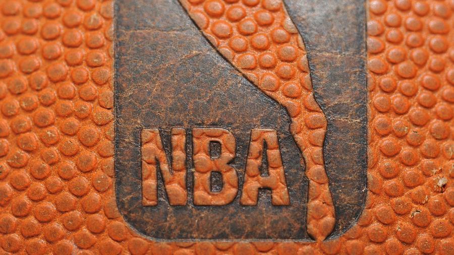 NBA realizou testes em 302 jogadores e teve os resultados divulgados hoje - GARRETT ELLWOOD/AFP