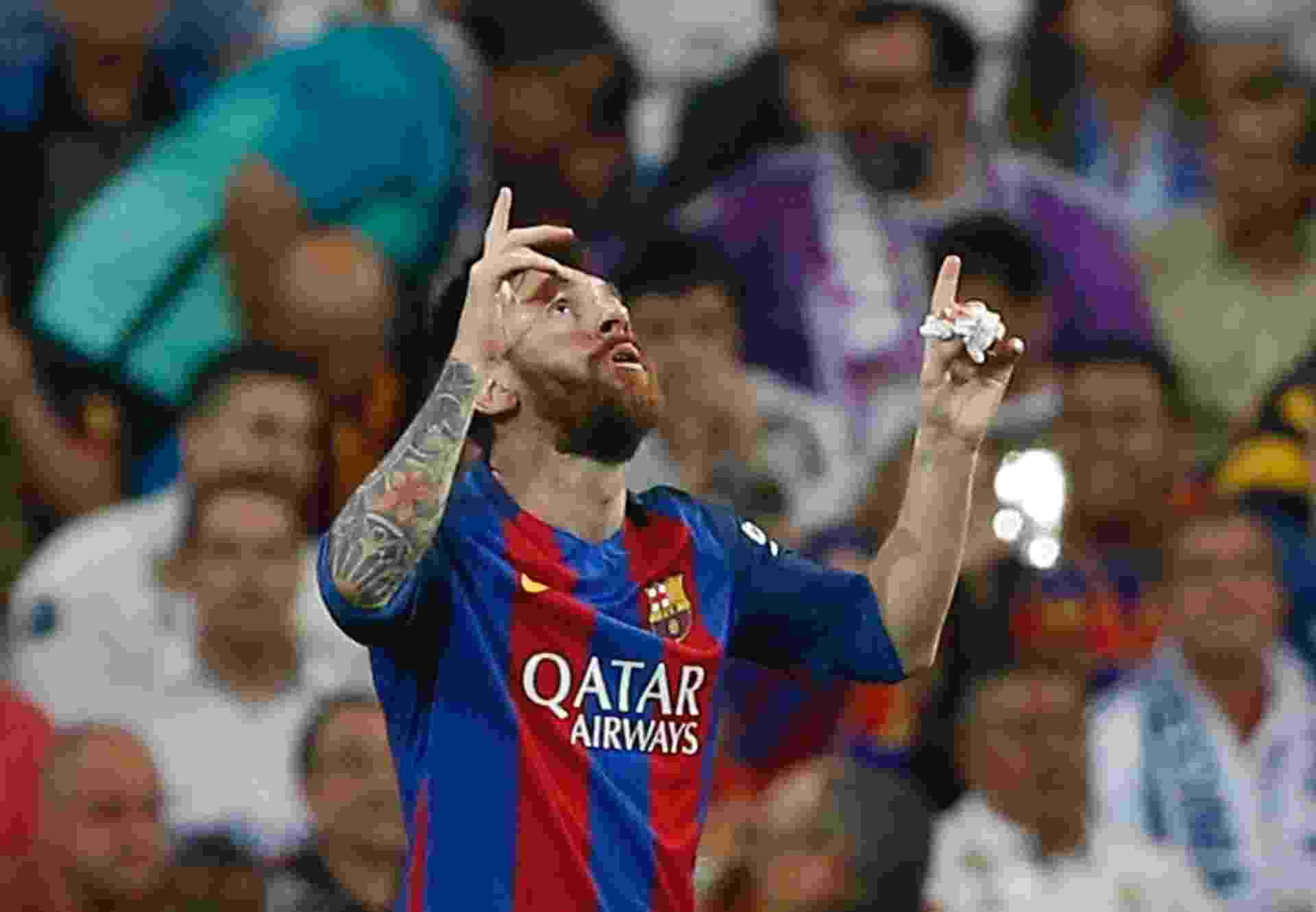 Messi comemora após empatar o placar contra o Real Madrid - Reuters / Susana Vera