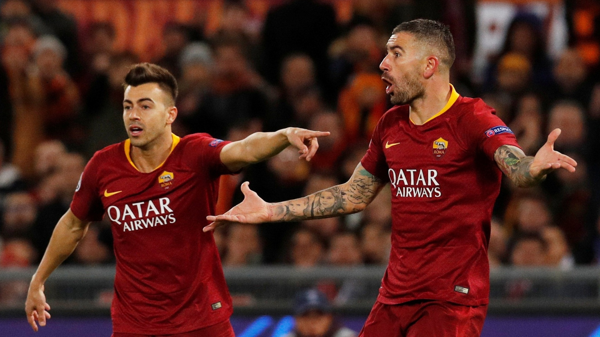 El Shaarawy gesticula ao lado de Kolarov em Roma x Real Madrid