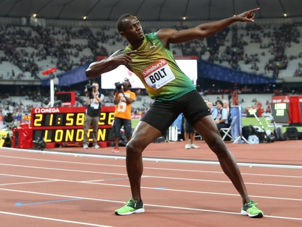 26.jul.2013 - Usain Bolt comemora vitória nos 100 m rasos da Liga de Diamante de Londres com o tempo de 9s85, sua melhor marca do ano