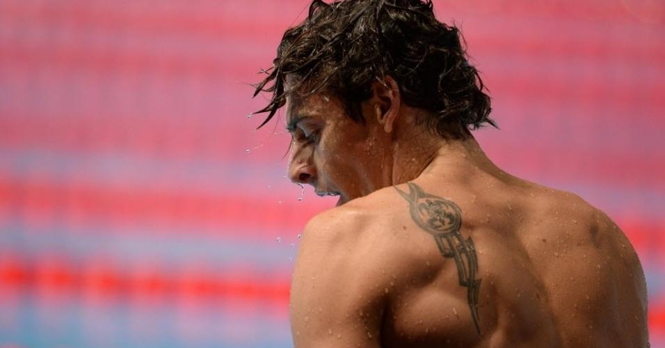 29.jul.2013 - Camille Lacourt, da França, mostra sua tatuagem nas costas nas eliminatórias da natação