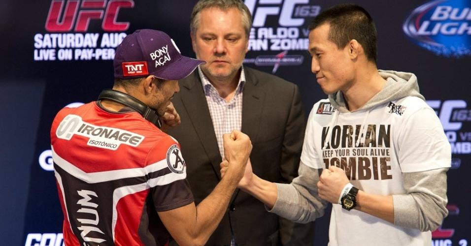 01.ago.2013 - José Aldo e Chan Sung Jung, o Zumbi Coreano, se encaram antes do combate deste sábado pelo UFC Rio 4