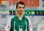 Zizao dá sorte, e brasileiro se torna o mais jovem campeão no tênis de mesa - Arte/UOL