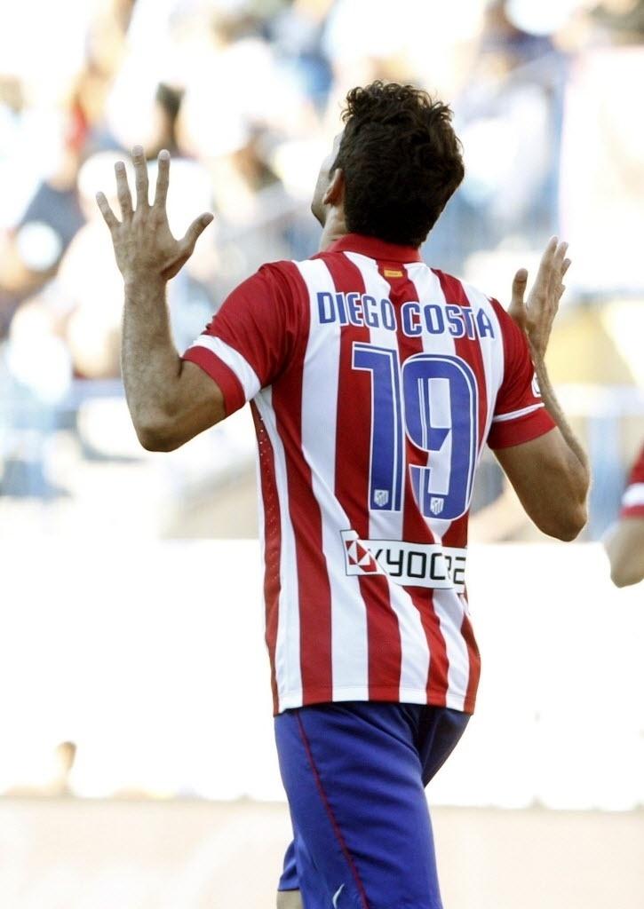 25.ago.2013 - Brasileiro Diego Costa comemora após marcar para o Atlético de Madri contra o Rayo Vallecano