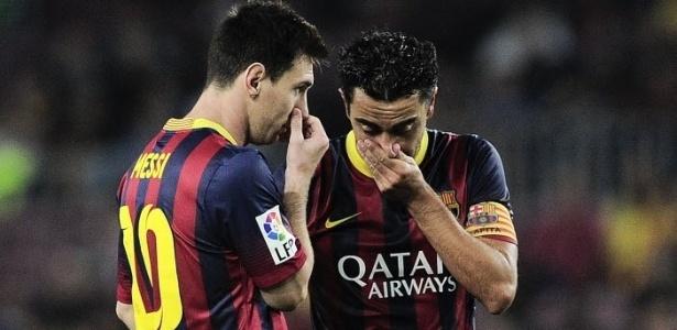 Xavi e Messi em ação pelo Barcelona, na temporada 2013-14