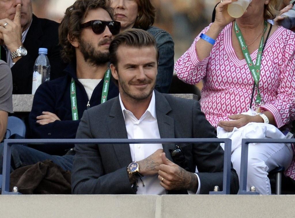 09.set.2013 - Ex-jogador de futebol britânico David Beckham assiste ao jogo entre Djokovic e Nadal na decisão do Aberto dos Estados Unidos de 2013