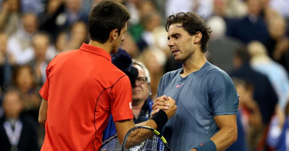 09.set.2013 - Rafael Nadal e Novak Djokovic após a final do US Open; espanhol venceu por 3 sets a 1