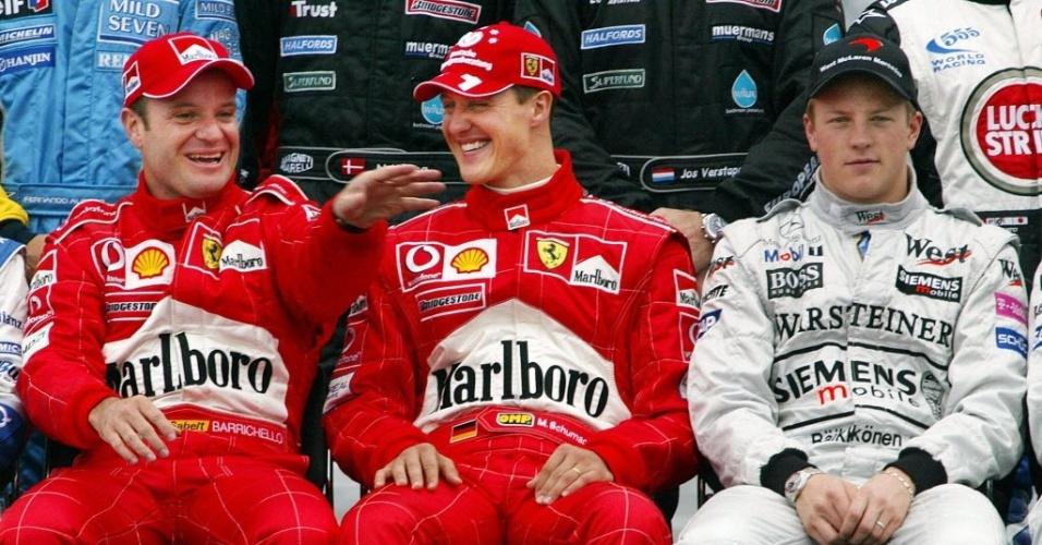Rubens Barrichello, Michael Schumacher e Kimi Raikkonen, em 2003, no Japão