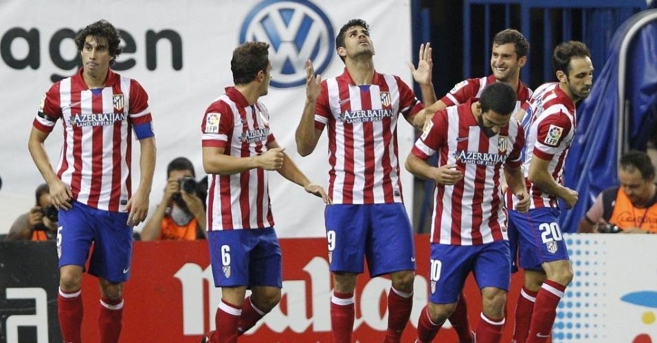 Brasileiro Diego Costa comemora após marcar para o Atlético da Madri na partida contra o Osasuna, pelo Campeonato Espanhol