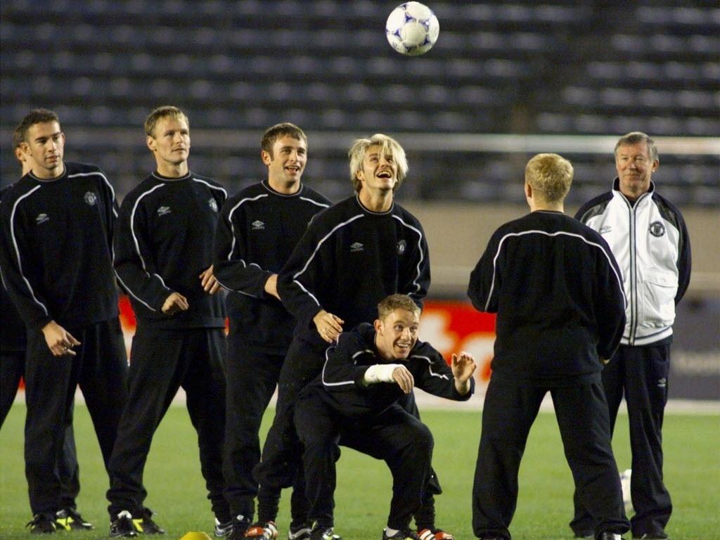 12.out.2013 - Em 1999, Higginbotham (e) era companheiro de um cabeludo Beckham no Manchester United que disputou o Mundial de clubes contra o Palmeiras