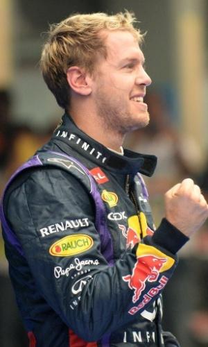 27.out.2013 - Sebastian Vettel sorri após vencer o GP da Índia e levar o tetracampeonato mundial de F-1