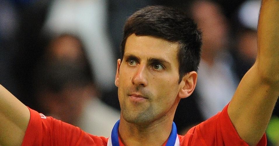15.nov.2013 - O sérvio Djokovic comemora a vitória sobre o tcheco Radek Stepanek na final da Copa Davis