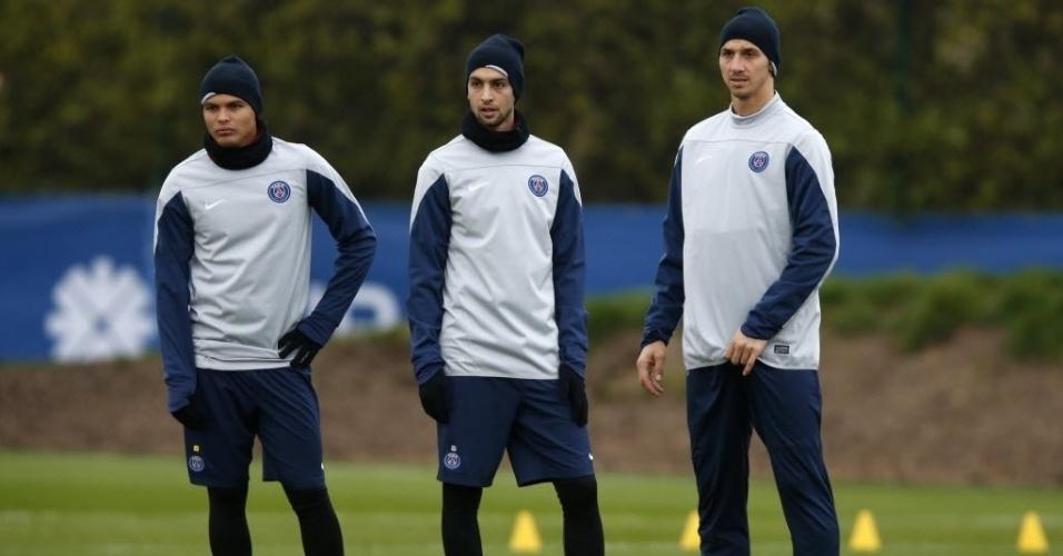 26.nov.2013 - Thiago Silva, Javier Pastore e Zlatan Ibrahimovic participam de trinamento do PSG em Paris; equipe enfrenta o Olympiacos na quarta-feira, pela Liga dos Campeões