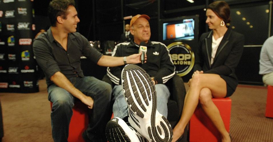 Oscar, maior cestinha do basquete brasileiro, e Maurren Maggi, campeã olímpica do atletismo, participam de evento de pôquer