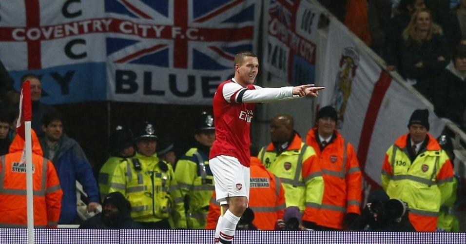 24.jan.2014 - Lukas Podolski comemora após marcar para o Arsenal contra o Coventry City, pela Copa da Inglaterra