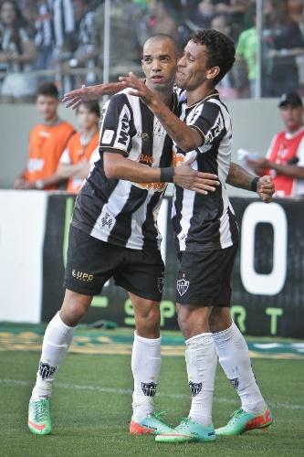 23. fev. 2014 - Diego Tardelli comemora gol marcado contra o América, pelo Campeonato Mineiro