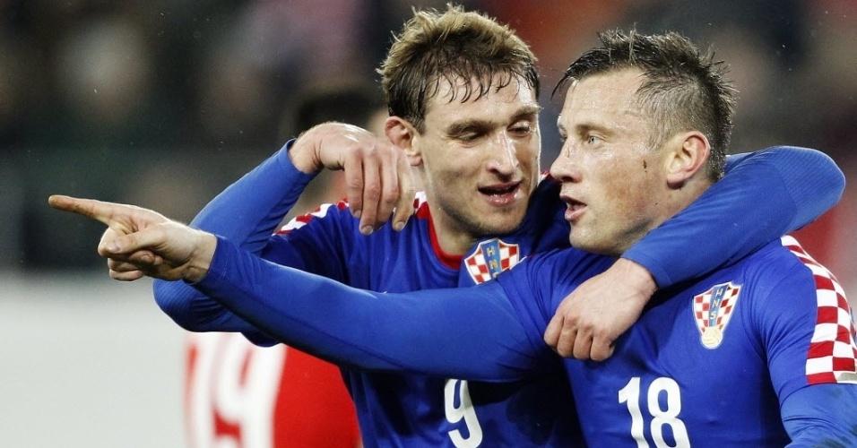 05.mar.2014 - Ivica Olic comemora um dos gols que marcou para a Croácia no amistoso contra a Suíça. Os croatas serão os primeiros adversários do Brasil na Copa do Mundo