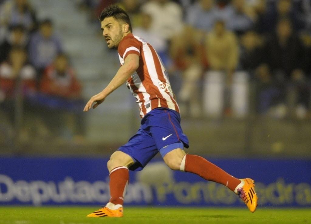 08.03.2014 - David Villa comemora um de seus dois gols no triunfo do Atlético de Madri, por 2 a 0, sobre o Celta de Vigo