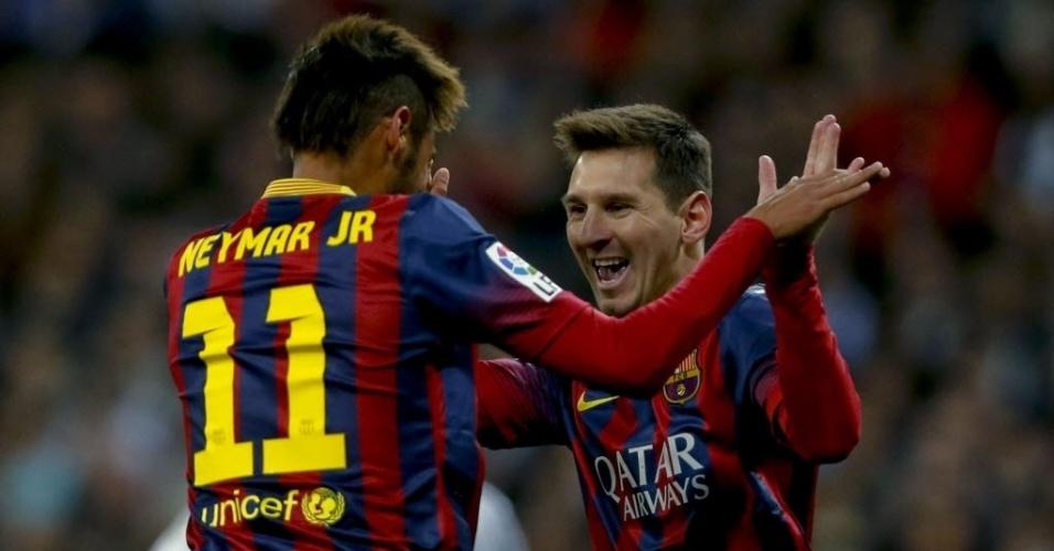 23.03.2014 - Messi e Neymar vibram com gol marcado. O argentino fez três na vitória sobre o Real Madrid