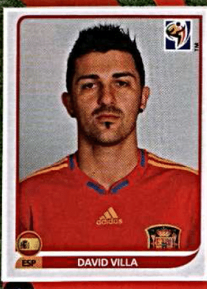 David Villa/Espanha-2010: O atacante espanhol foi o mais recente ostentador de bigode nos álbuns da Copa, apesar do barbear estar fora de moda à época. Além do bigode, soma-se no visual do espanhol a pequena barbicha.