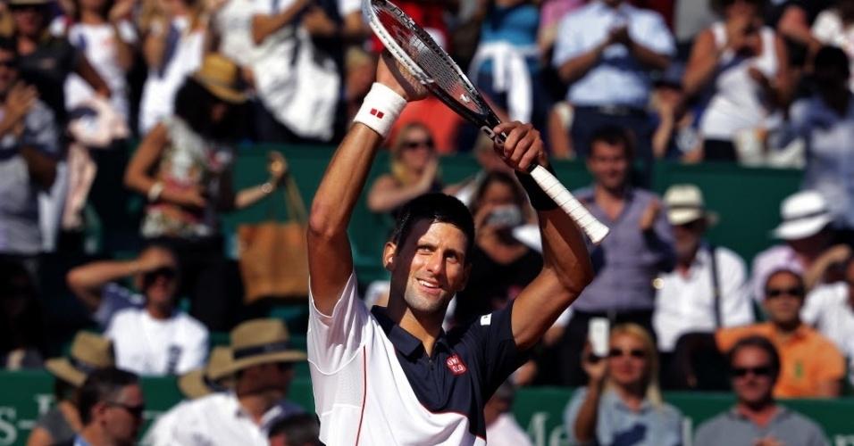 Novak Djokovic comemora após vencer o espanhol Pablo Carreno Busta