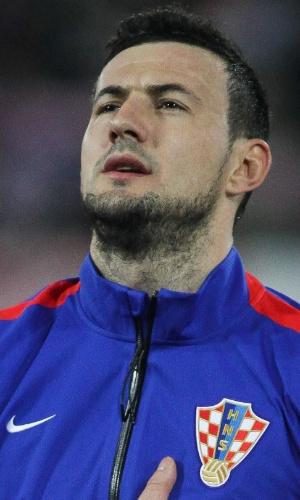 05.mar.2014 - Goleiro Danijel Subasic, da seleção croata, canta o hino nacional do seu país antes do amistoso contra a Suíça