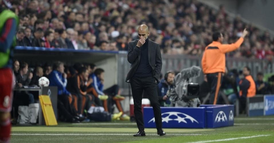 Técnico do Bayern, Guardiola demonstra preocupação com resultado contra o Real (29.abr.2014)