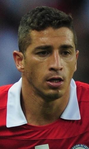 14.ago.2013 - Carlos Carmona, do Chile, parte com a bola dominada durante o amistoso contra o Iraque em Brondby (Dinamarca)