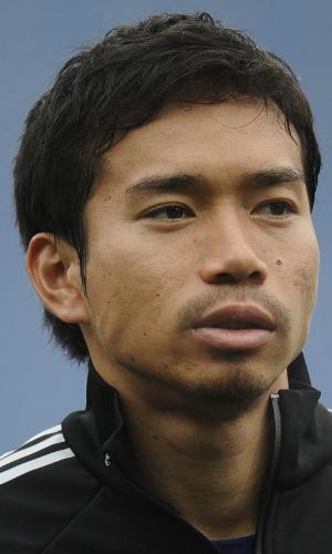16.nov.2013 - Yuto Nagatomo, do Japão, canta o hino nacional antes do amistoso contra a Holanda em Genk (Bélgica)