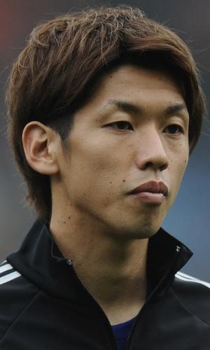 16.nov.2013 - Yuya Osako, do Japão, se perfila antes de amistoso contra a Holanda em Genk (Bélgica)