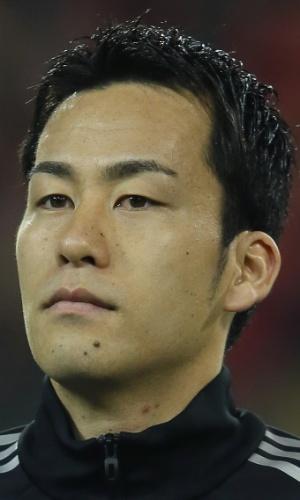 19.nov.2013 - Maya Yoshida, do Japão, se perfila antes do amistoso contra a Bélgica em Bruxelas