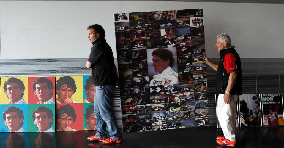 Funcionários preparam exposição de fotos de Senna no circuito de Ímola, na Itália