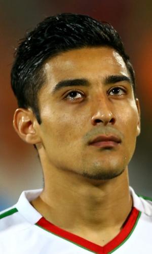 15.out.2013 - Reza Ghouchannejad, do Irã, fica perfilado antes da partida contra a Tailândia pelas eliminatórias da Copa da Ásia