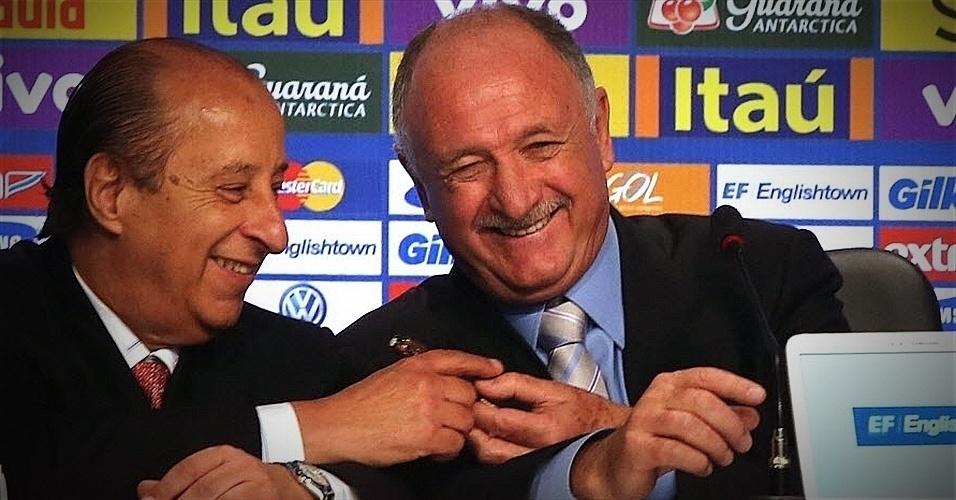 07.mai.2014 - Felipão (dir.) brinca com Marco Polo del Nero durante anúncio dos 23 jogadores convocados para a Copa do Mundo