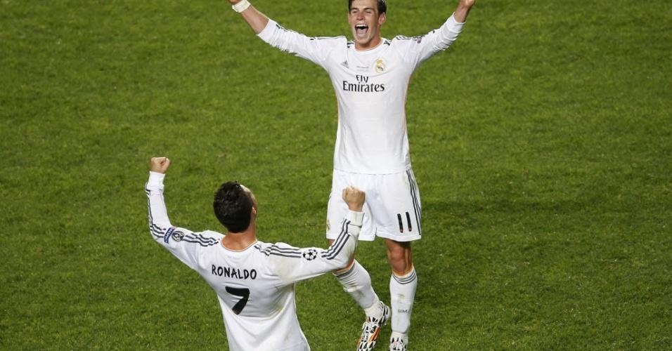 24.mai.2014 - Bale e Ronaldo, autores de dois gols na prorrogação, comemoram título